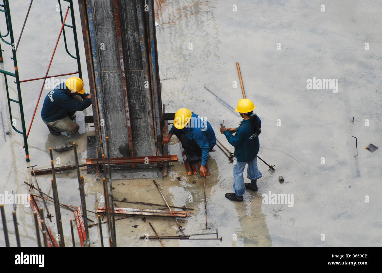 workers check reinforced steel construction in the rain hotel stock photo 21030363 alamy. Black Bedroom Furniture Sets. Home Design Ideas