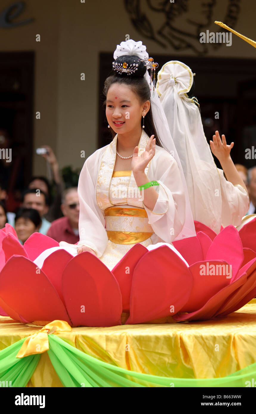 Chinese float stock photos chinese float stock images alamy young chinese girl in traditional costume sitting in a lotus flower during a chinese new year dhlflorist Choice Image