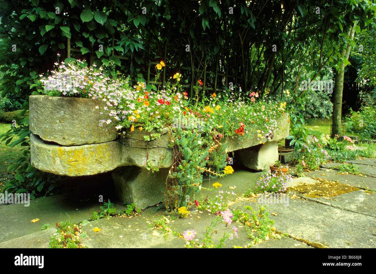 Stone Garden Troughs Old carved stone sarcophagus from churchyard used as garden planter old carved stone sarcophagus from churchyard used as garden planter wiltshire uk workwithnaturefo