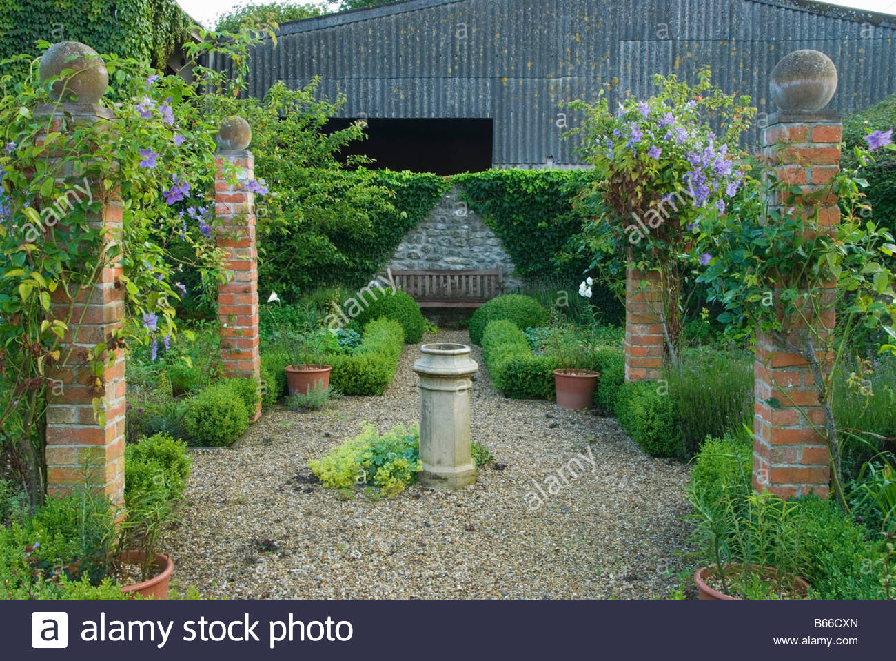 Courtyard Garden Defined With Brick Pillars Hosting Rosa Climbing