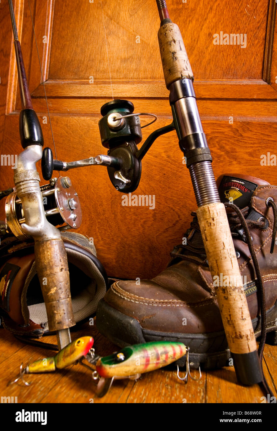 Old fishing tackle rods and reels in a corner with hiking boots ...