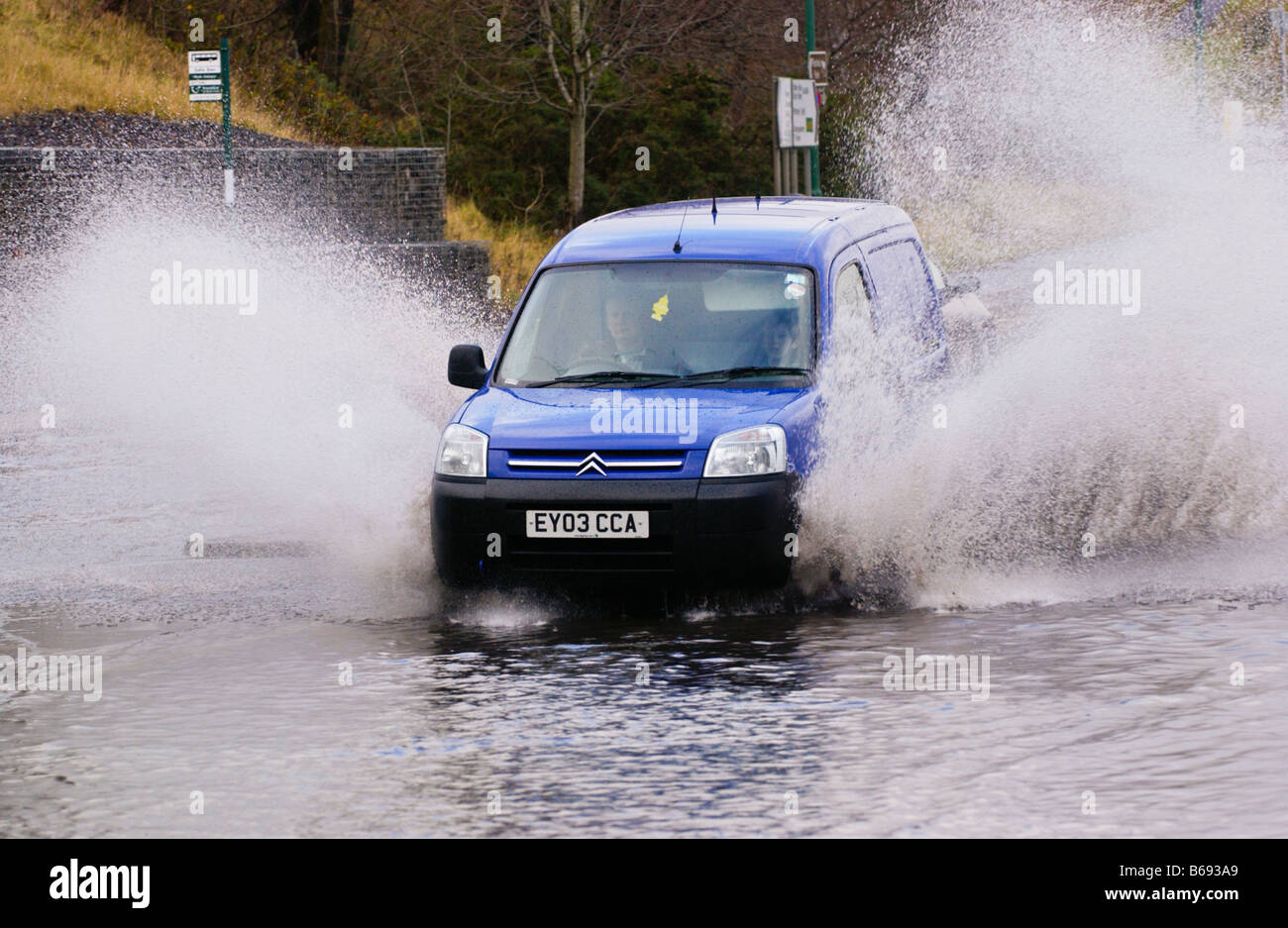 cars drive through flood water splash after road flooded by heavy stock photo royalty free. Black Bedroom Furniture Sets. Home Design Ideas