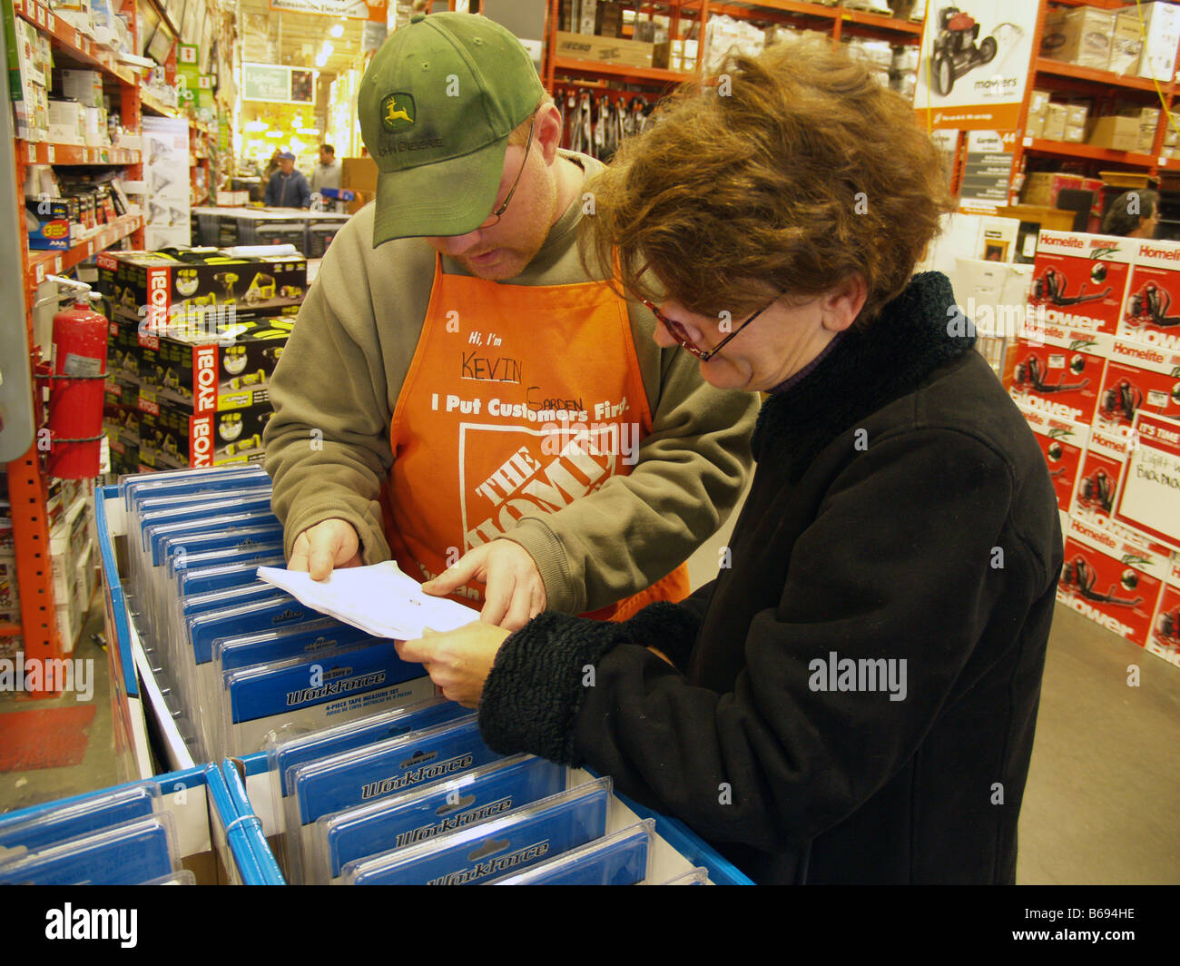Shopper receiving help from a sales associate at a home for Shop home depot