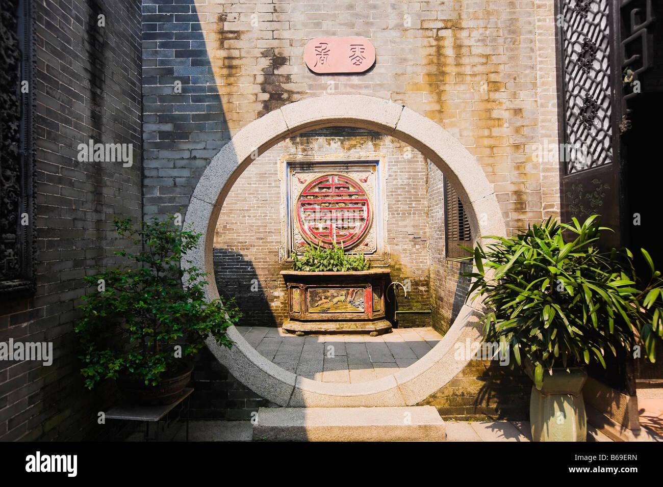 Decorating circular door images : Potted plants near a circular door, Yu Yin Shan Fang, Panyu Stock ...
