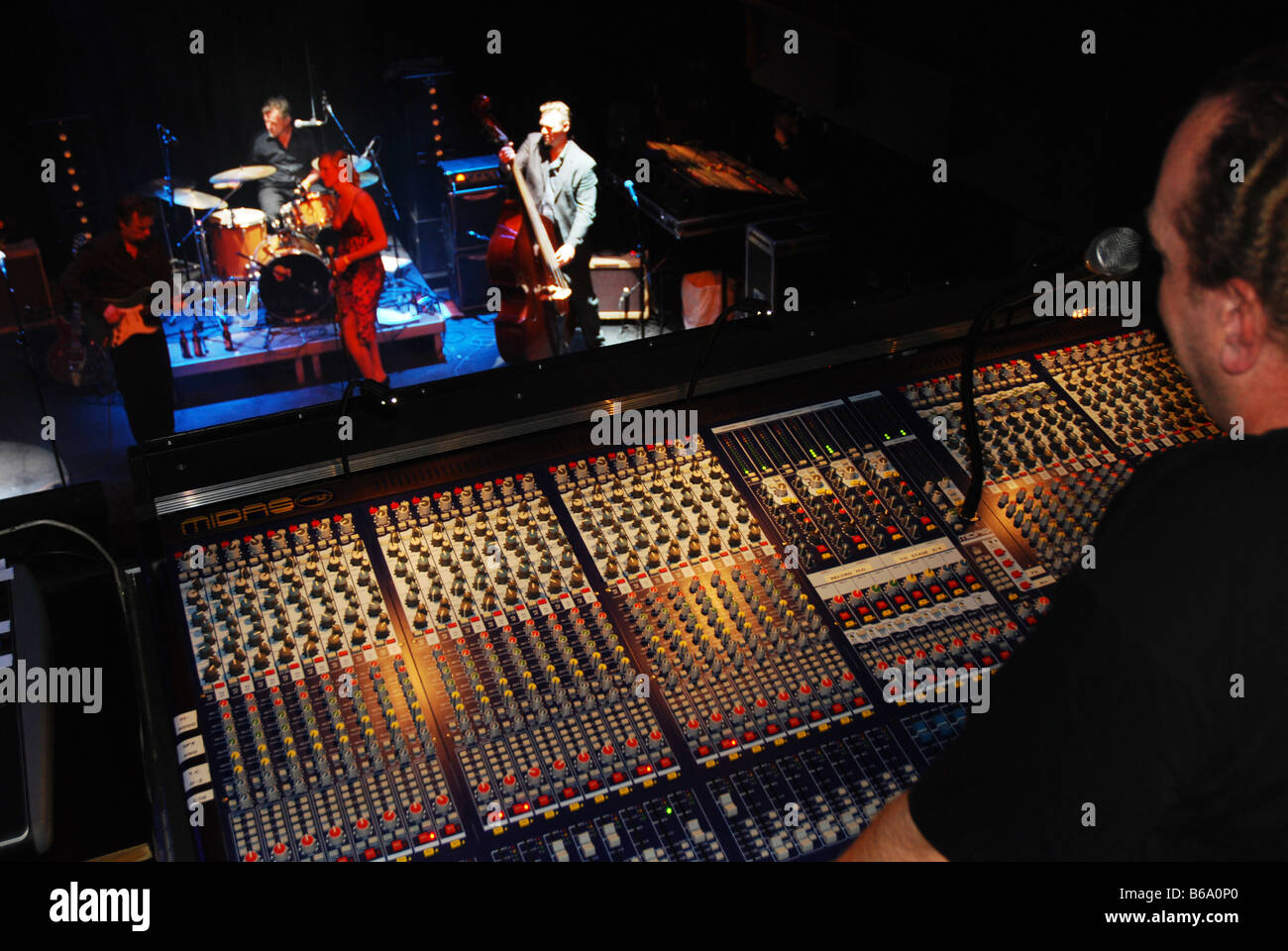 Sound Technician At Work At Rock Concert Stock Photo