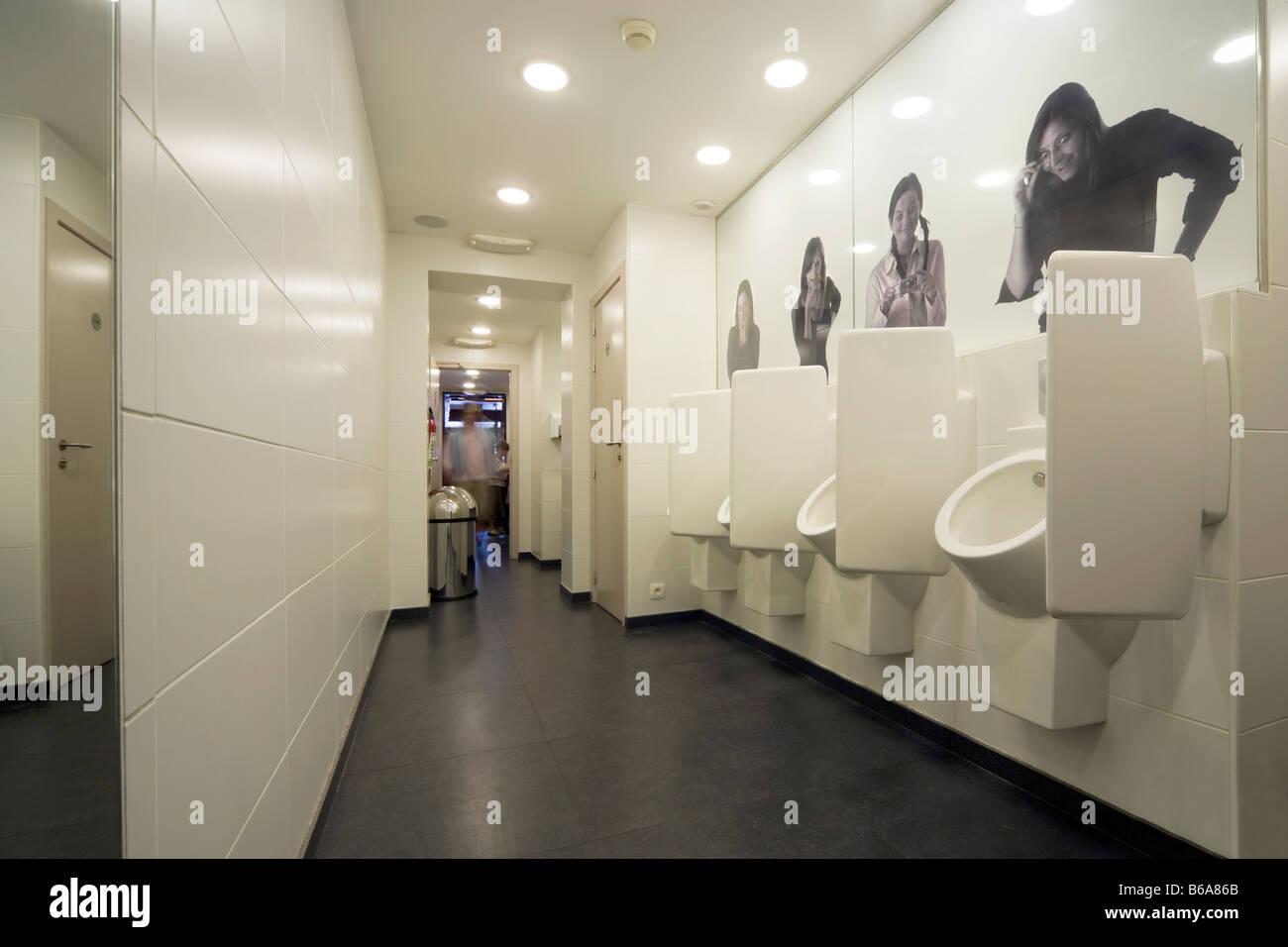 Mens Bathroom; Restroom; Toilet; Urinals At A Brussels Restaurant. 4 Women  Onlookers, Amused, Making Jokes
