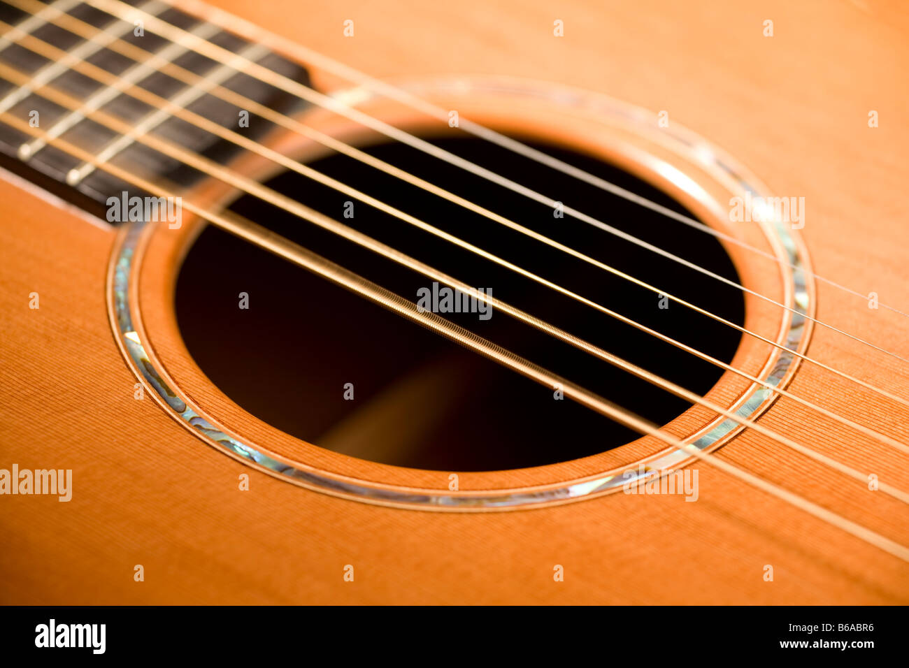 close up of sound hole of acoustic guitar with vibrating strings stock photo royalty free image. Black Bedroom Furniture Sets. Home Design Ideas