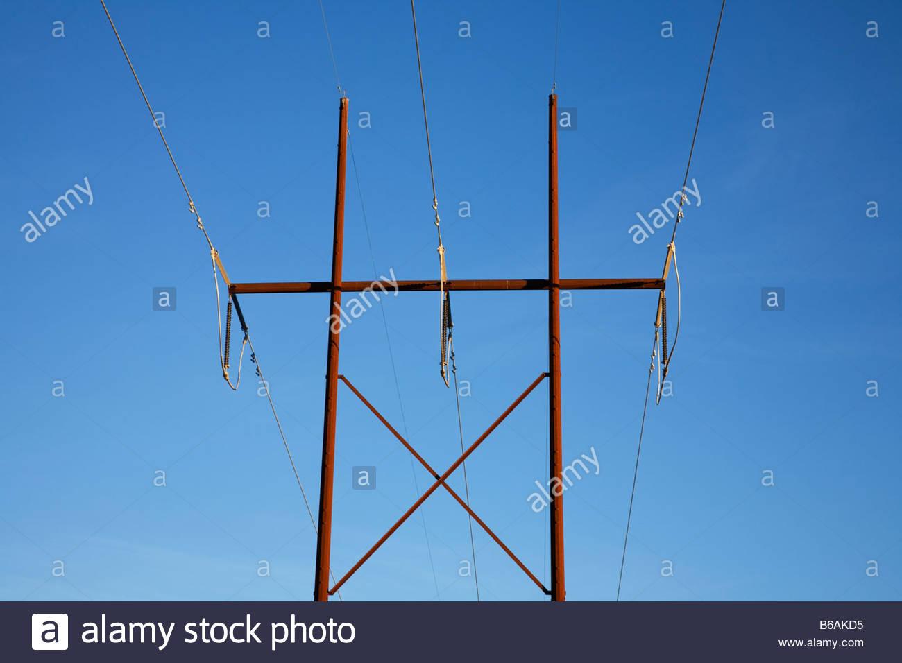 stock photo weathering steel power poles cor ten steel corten steel blue sky power lines