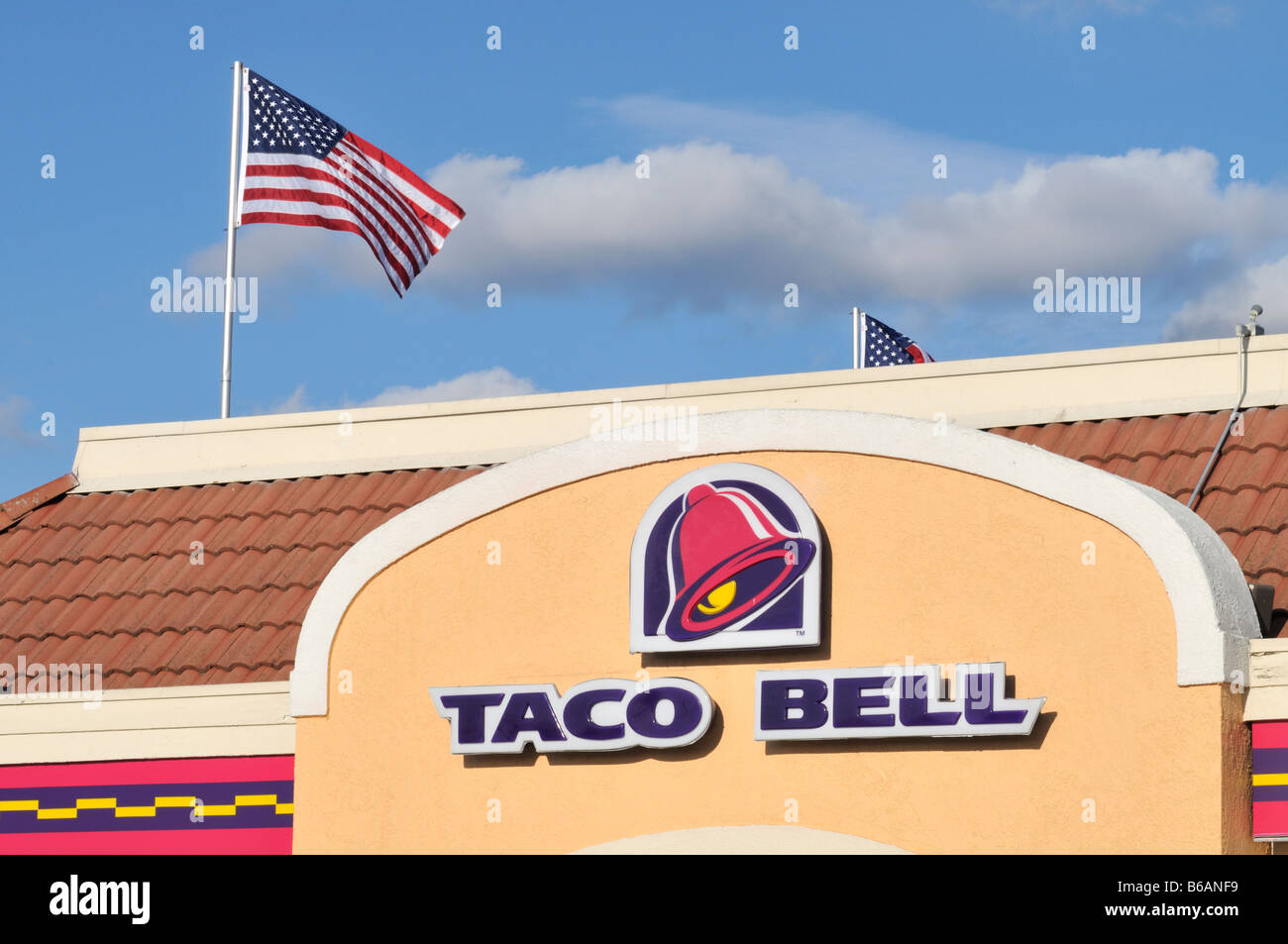 Taco Bell Logo taco bell logo and sign on the exterior of restaurant with