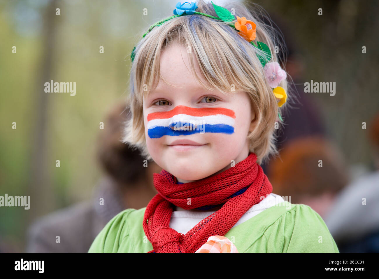 with dutch flag face paint on kingsday queensday kings day