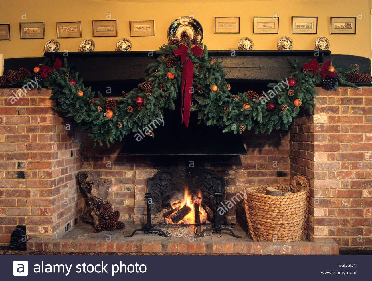 coates manor sussex christmas decorations fireplace with garland