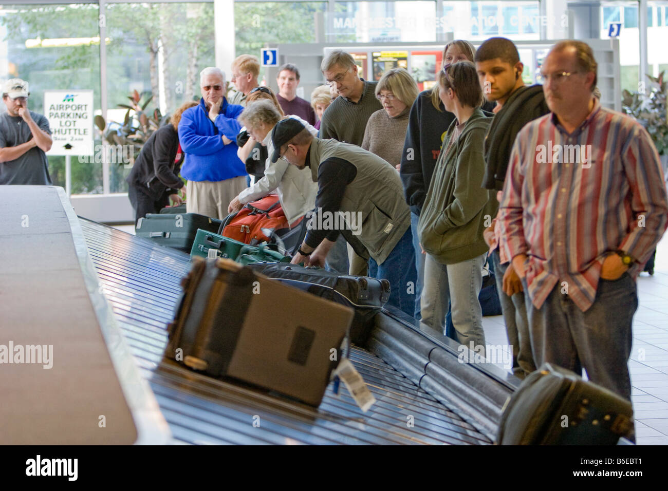 Passengers Wait For Their Luggage To Arrive At Manchester Airport ...