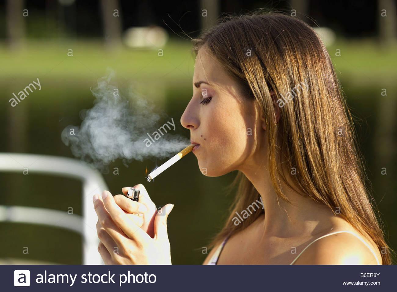beautiful woman lighting a cigarette  sc 1 st  Alamy & beautiful woman lighting a cigarette Stock Photo Royalty Free ... azcodes.com