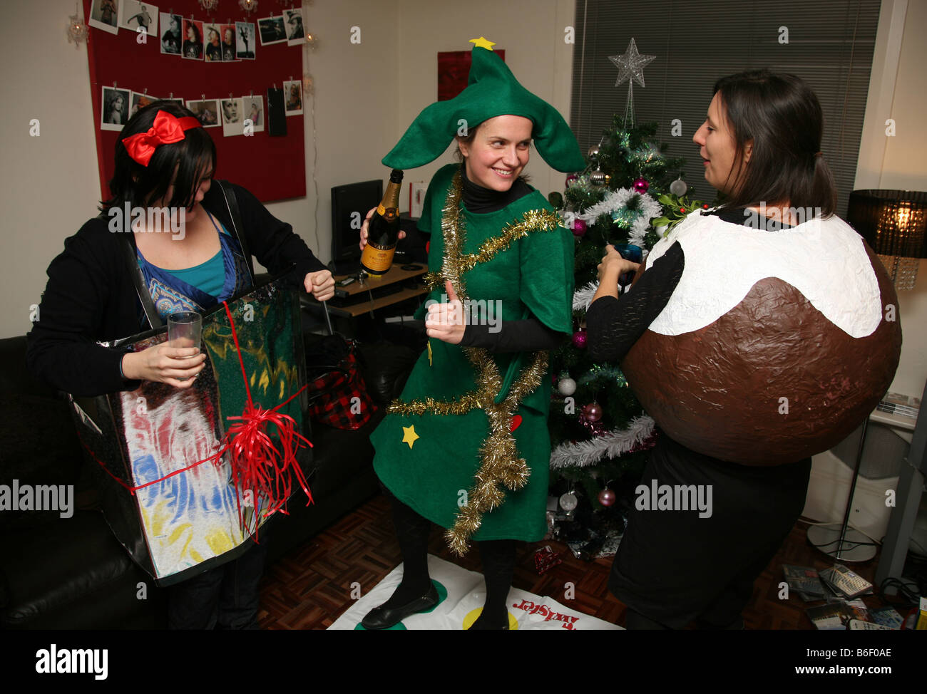 3 woman in fancy dress drunk and dancing at a christmas party ...