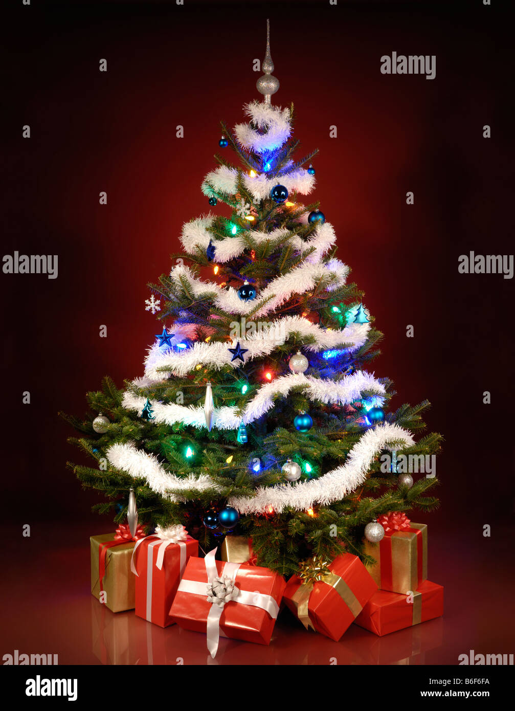 Christmas tree with presents and lights -  Shining Christmas Tree With Gifts Under It Stock Photo