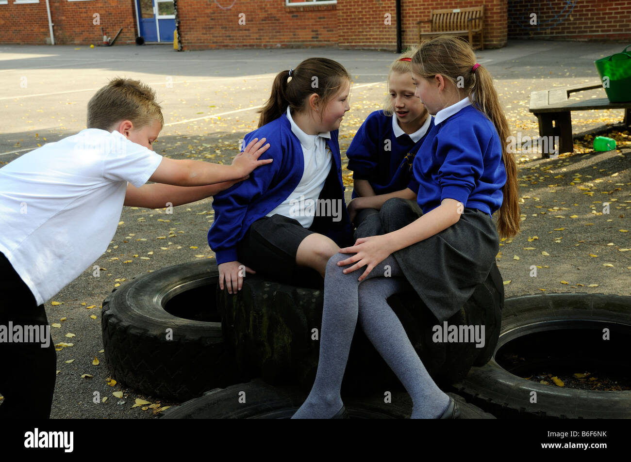 Photo - Boy bullying and pushing a group of girls in a primary school ...