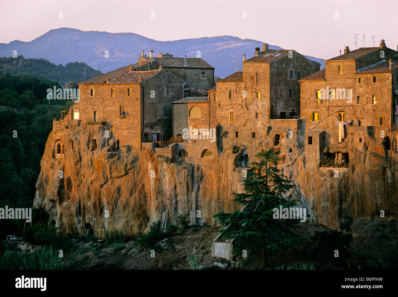 houses built on cliffs of tuff pitigliano province of grosseto stock photo royalty free image. Black Bedroom Furniture Sets. Home Design Ideas