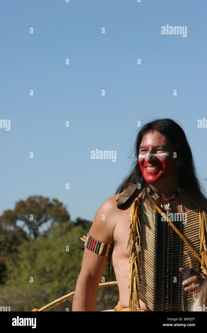 a smiling apache native american indian on horseback stock photo
