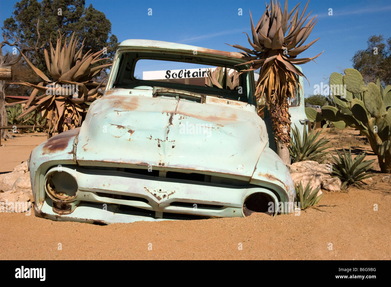 Stock photo wreck of a classic car in the desert town of solitaire namibia africa