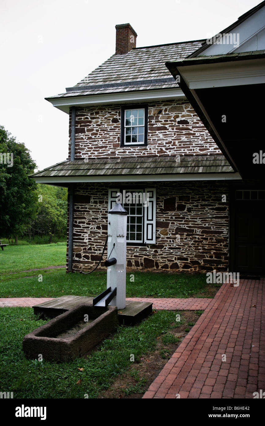 Backyard Walkway And Water Pump Of A Colonial American Stone Farmhouse In Rural Pennsylvania