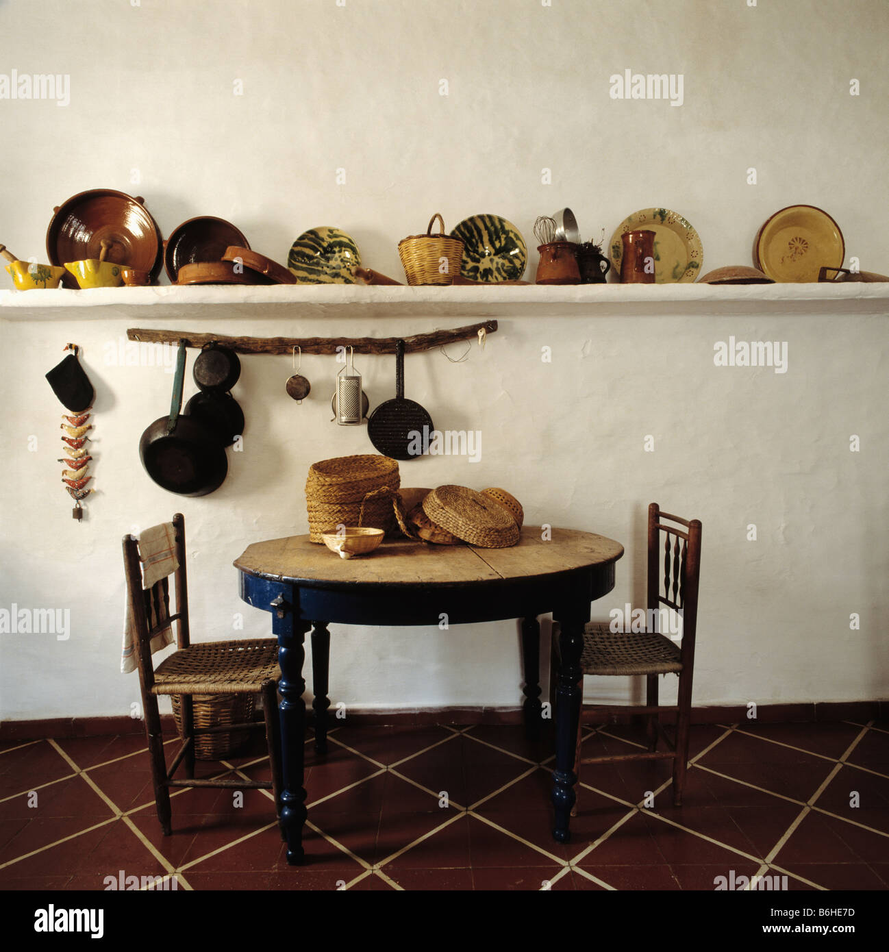 circular table and old wooden chairs in kitchen dining room with