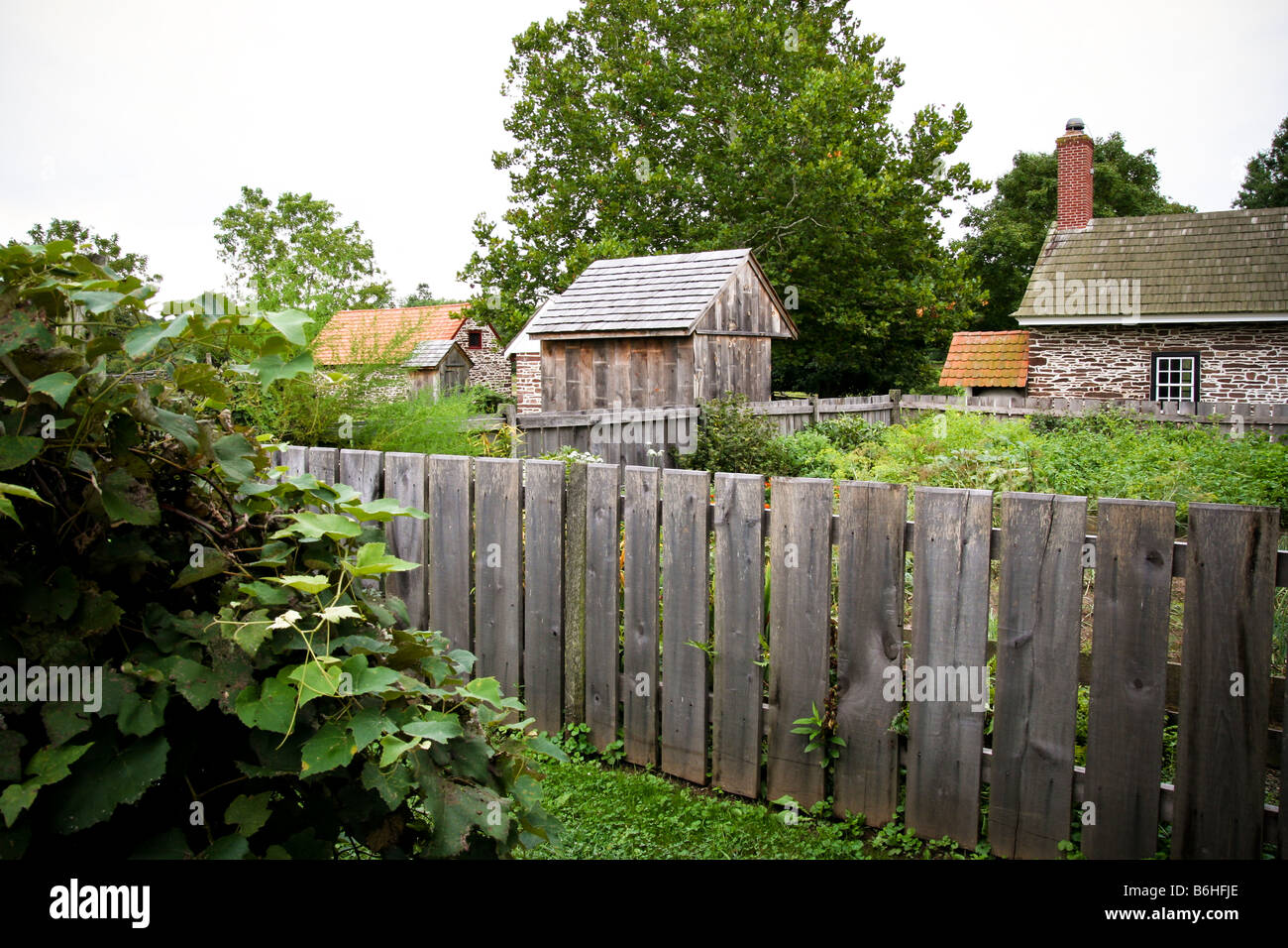 Kitchen garden area of an old 18th century farmstead with a rustic stock photo royalty free - Rustic wood fences a pastoral atmosphere ...