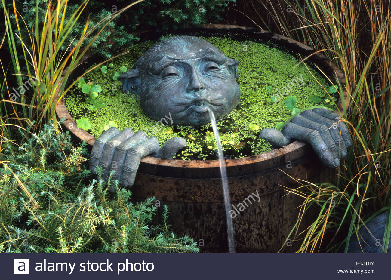 Water feature wooden half barrel pond with spitting man for Pond with fountain