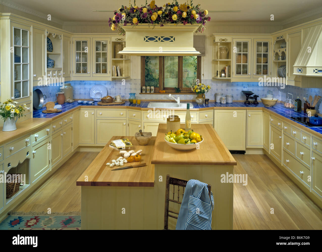 Architectural Interior Design Homes Houses Estate Kitchen Appliances Island Counter Lighting Pots Pans Showroom Stock Photo