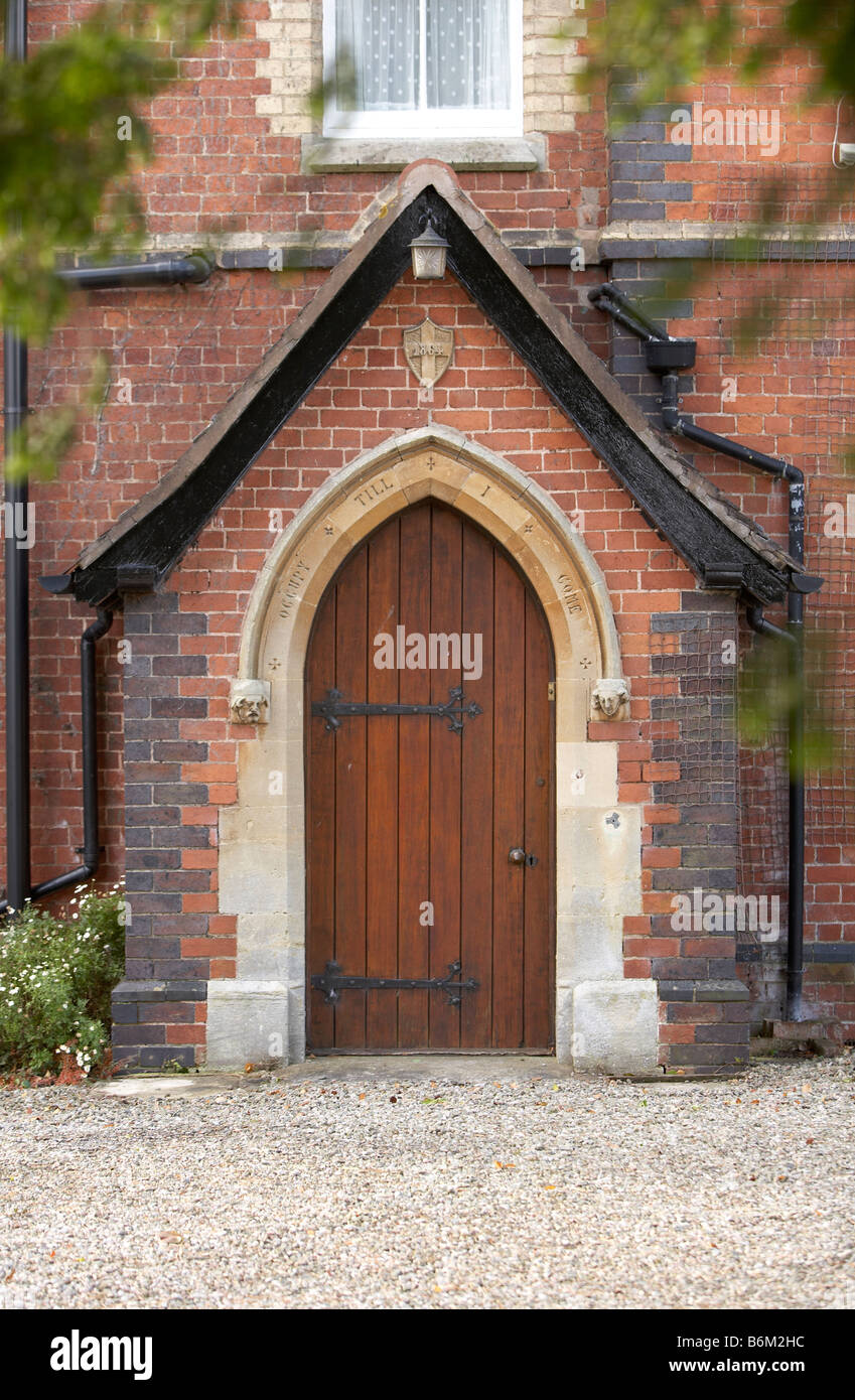 Gothic Victorian Porch And Door In Red Brick House