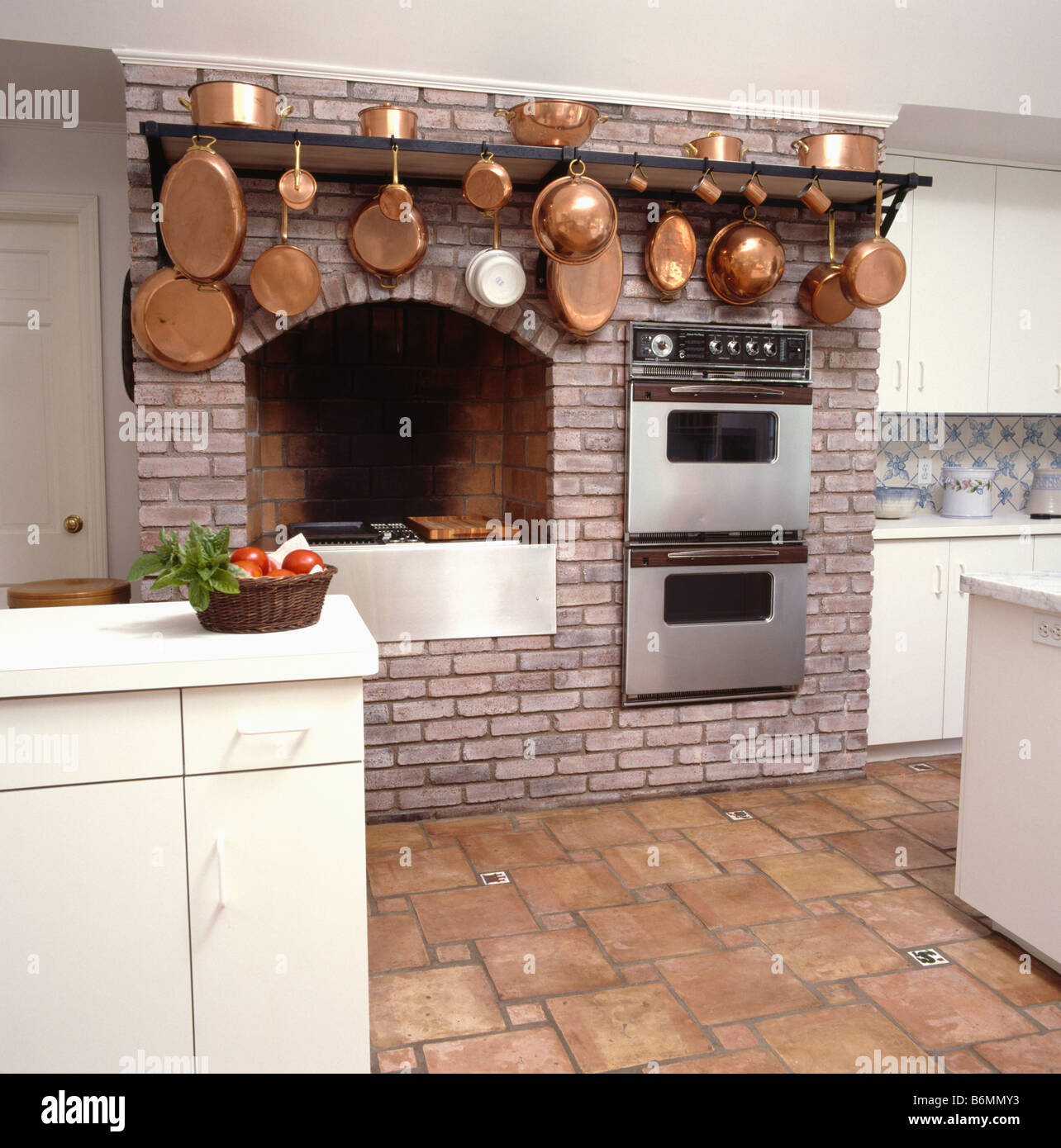 Terracotta Floor Tiles Kitchen Copper Pans On Rack Above Double Ovens And Hob Fitted Into Brick