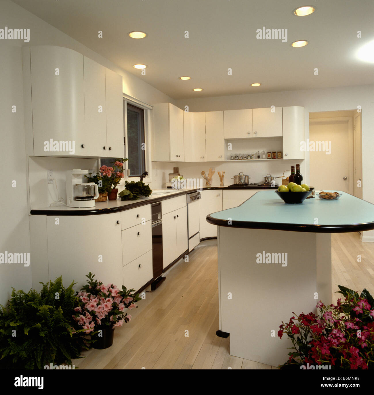 Kitchen Worktop Lighting: Downlighting And Curved Island Unit With Pale Blue Worktop