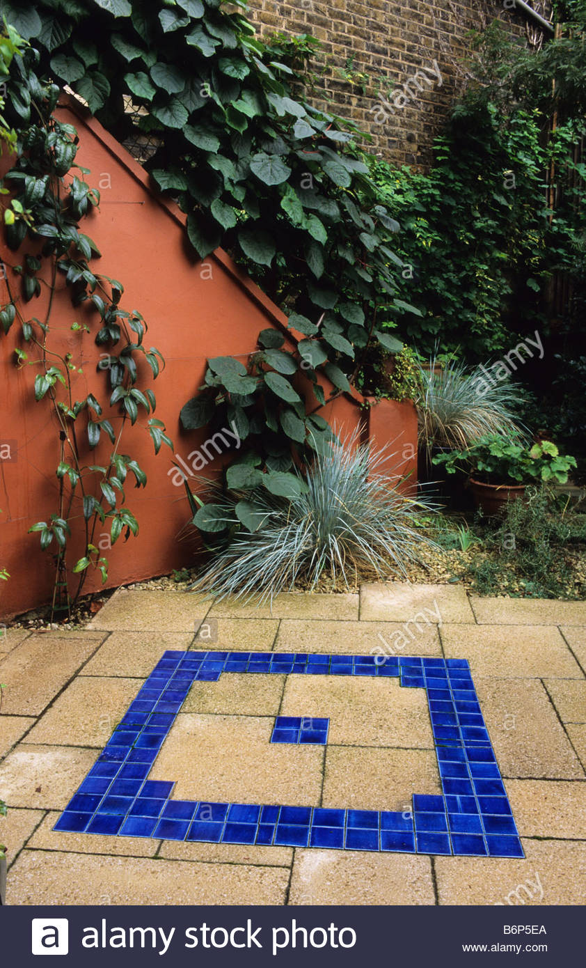 Private Town Garden London Design Pamela Woods Mediterranean Patio Garden  With Blue Ceramic Tiles And Orange Colour Washed Wall