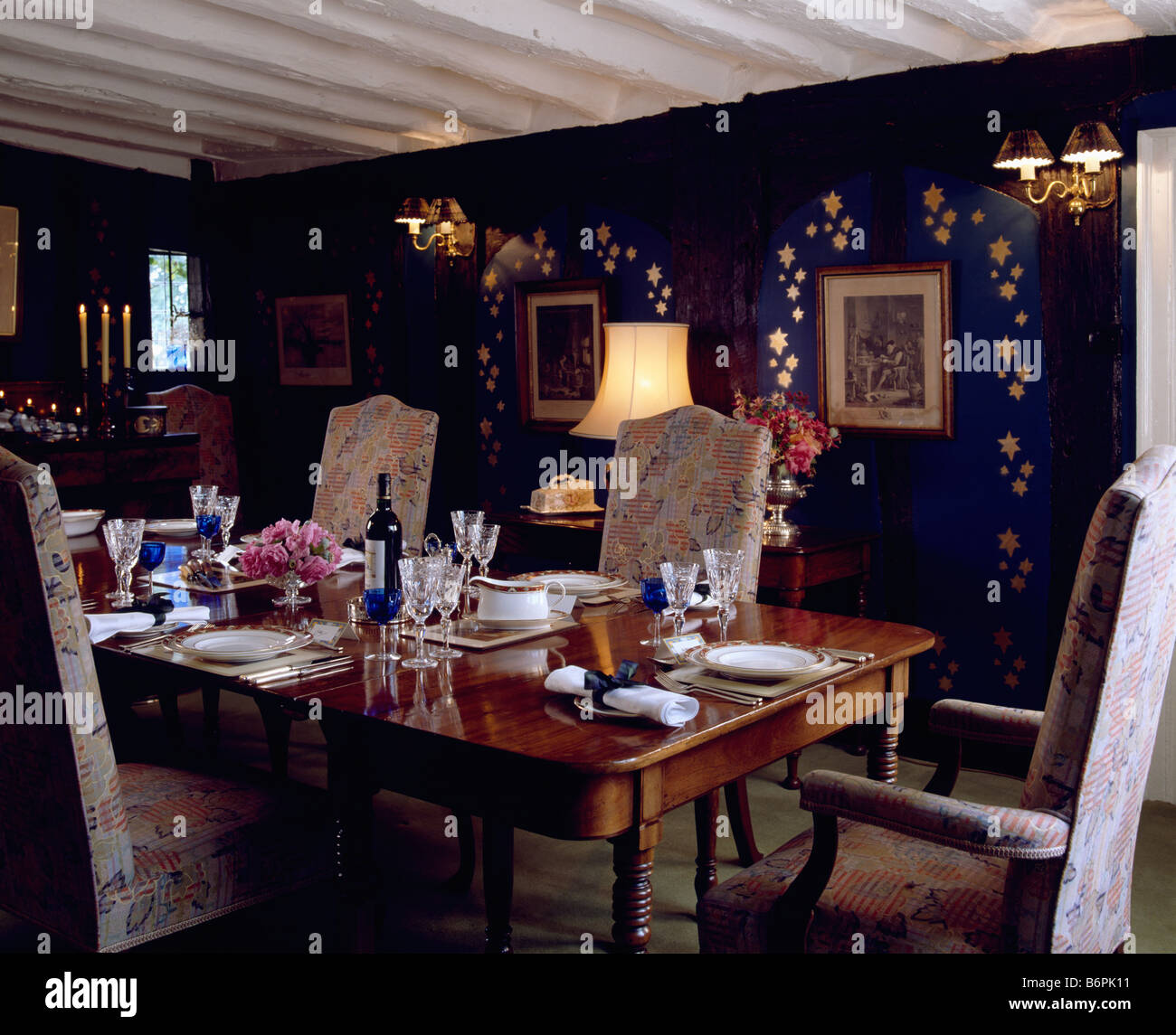 country dining room lighting. Table Set For Dinner In Country Dining Room With Lighted Lamps And Gold Stencilling On Blue Wall Lighting R