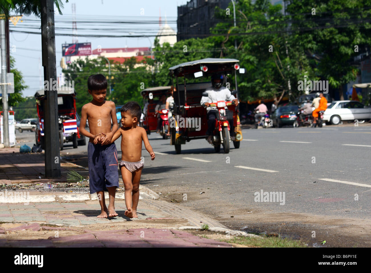 Stock Photo - Young local kids boy walking half naked and bare foot in ...: www.alamy.com/stock-photo-young-local-kids-boy-walking-half-naked...