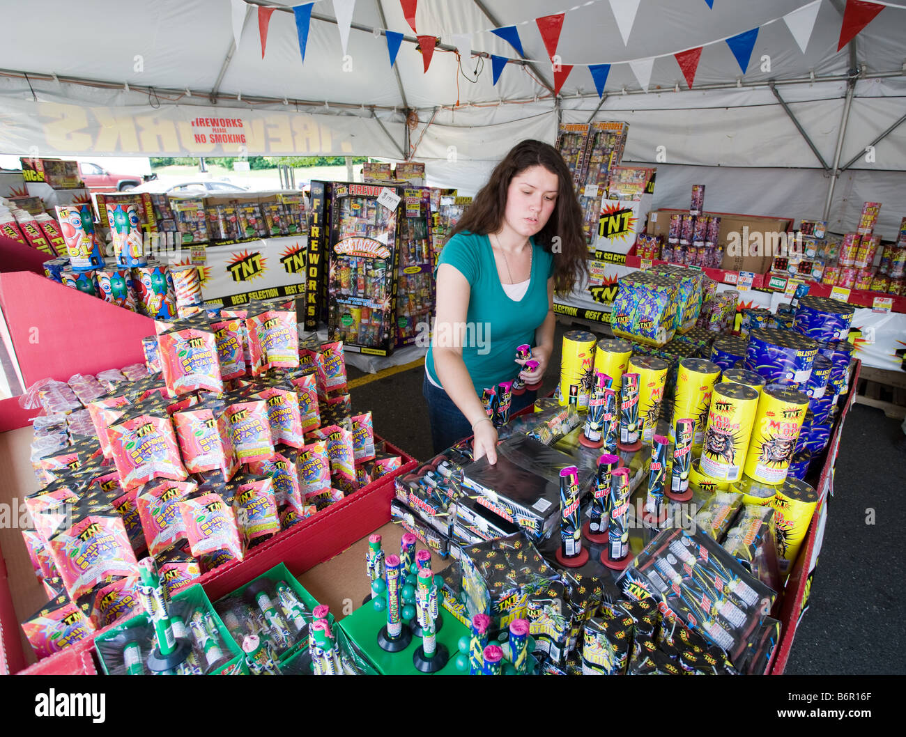 A young woman sells legal fireworks in a roadside stand tent in Milford Connecticut USA  sc 1 st  Alamy & A young woman sells legal fireworks in a roadside stand tent in ...