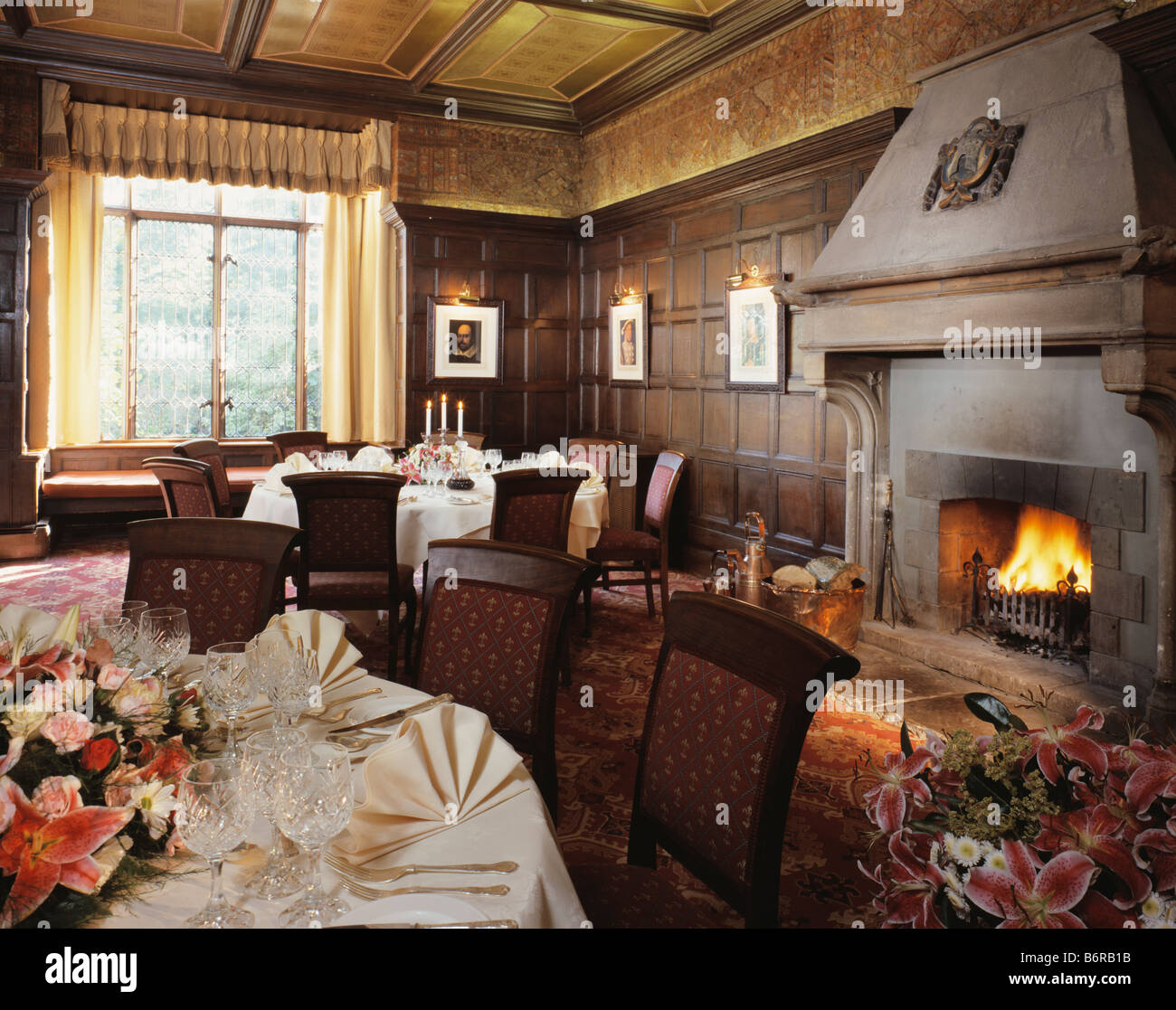 Lighted Fire In Large Fireplace In Paneled Country Hotel Dining Room Stock Photo Royalty Free