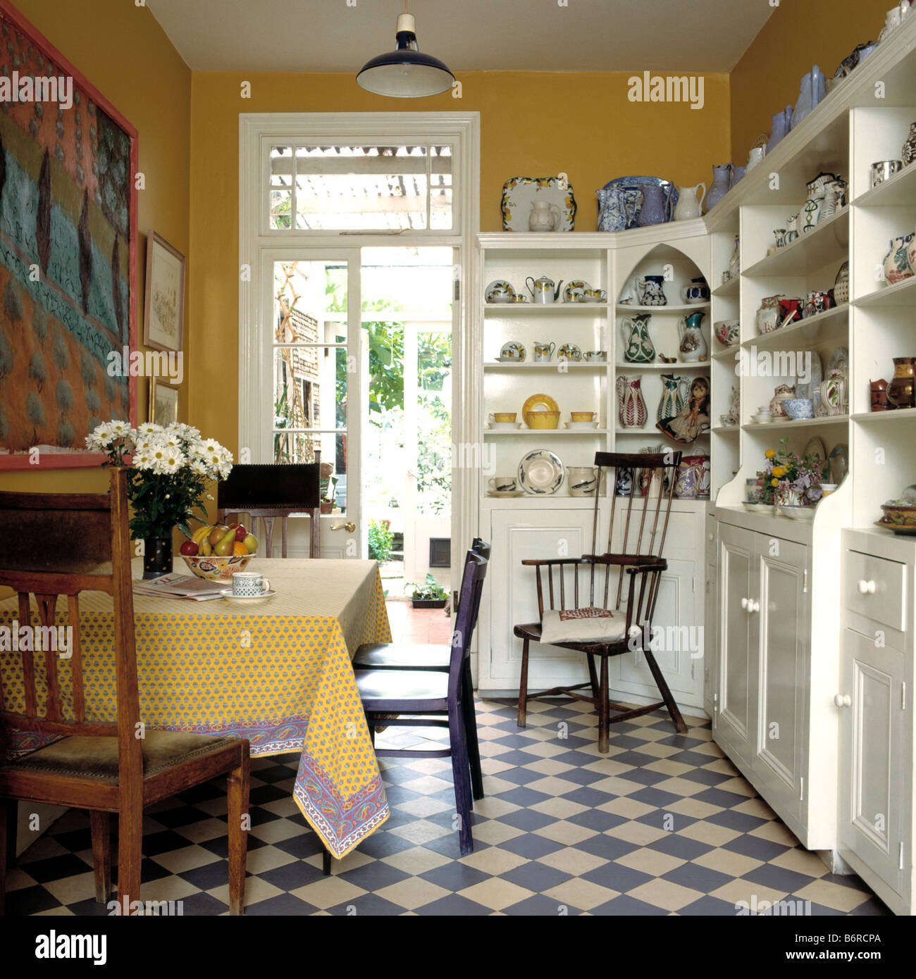 Blue And White Chequerboard Flooring In Yellow Dining Room
