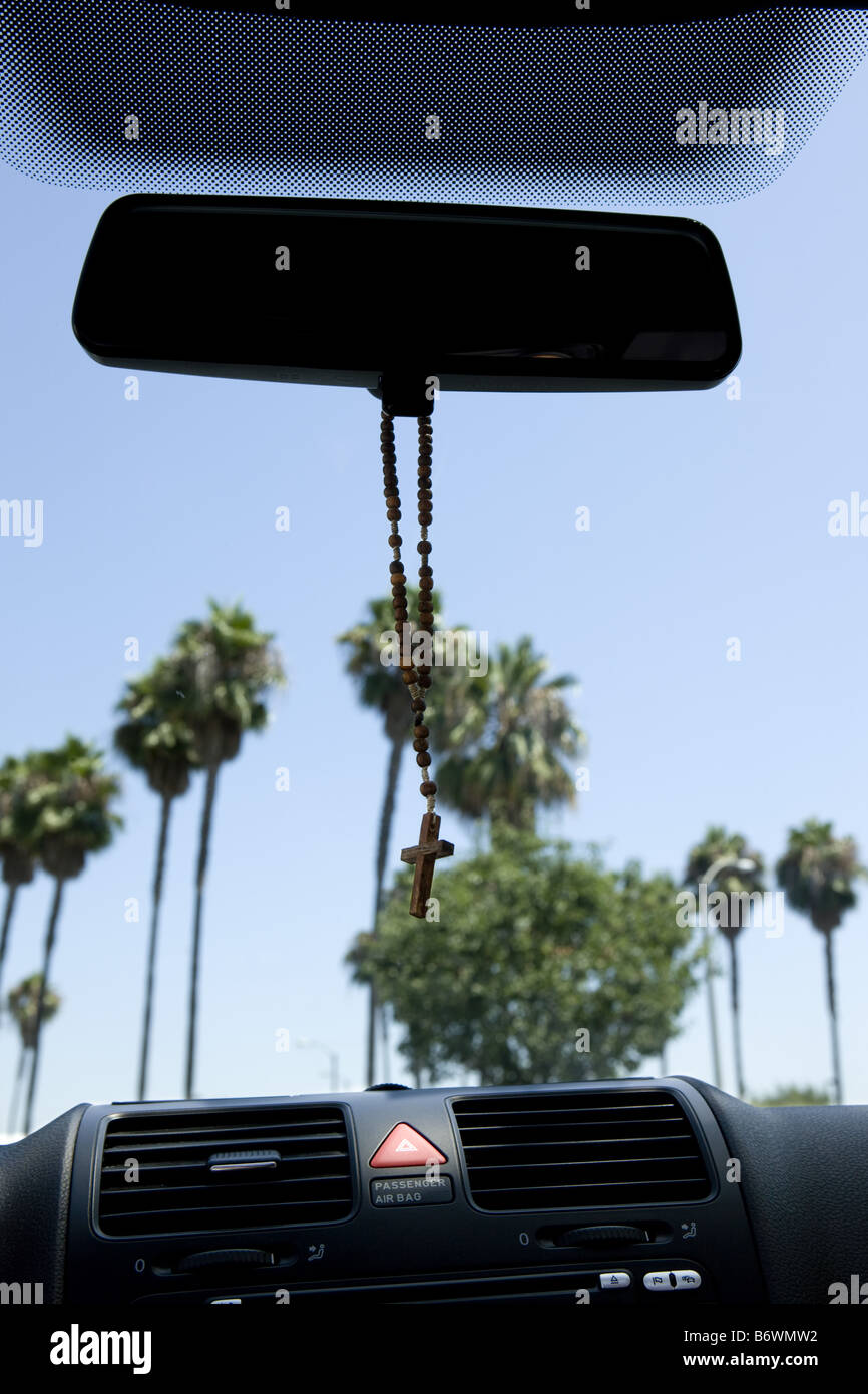 rosary hanging from rear view mirror of car stock photo royalty free image 21463486 alamy. Black Bedroom Furniture Sets. Home Design Ideas