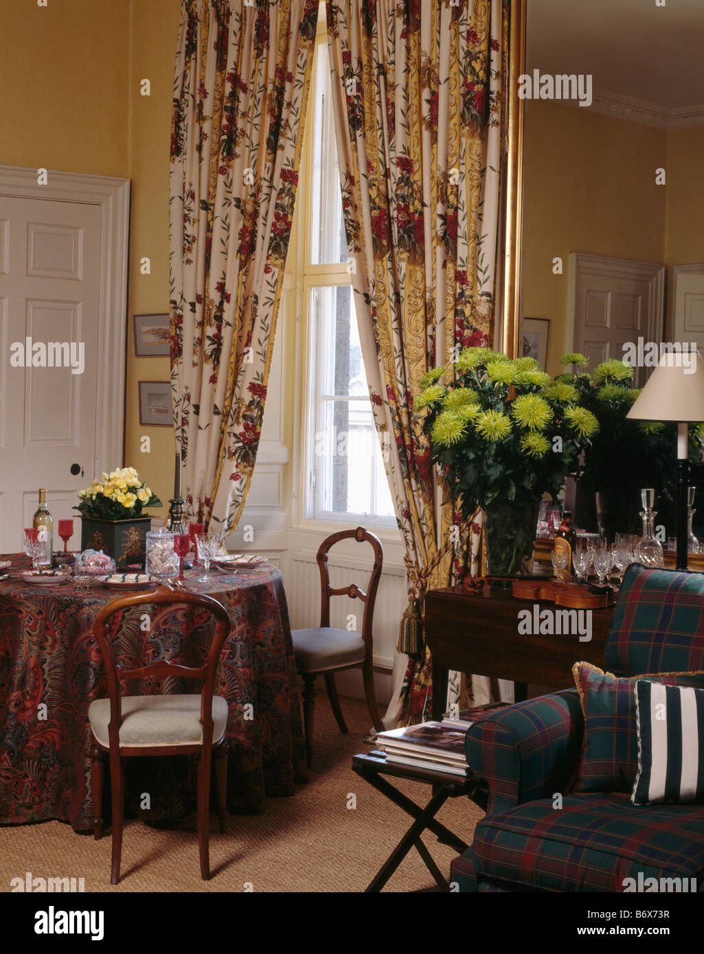 Red Cream Patterned Curtains In Dining Room With Lime Green Chrysanthemums Vase On Table Front Of Mirror