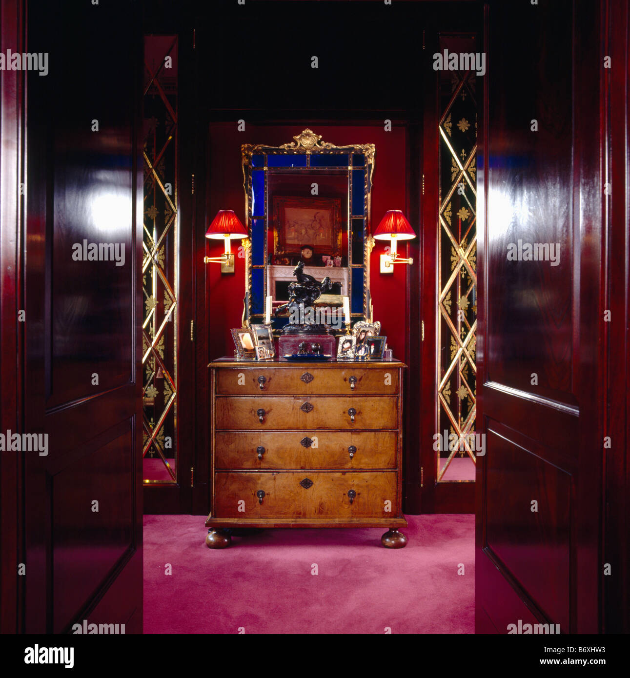 Double mahogany doors open to dressing room red wall lights and Stock Photo, Royalty Free Image ...