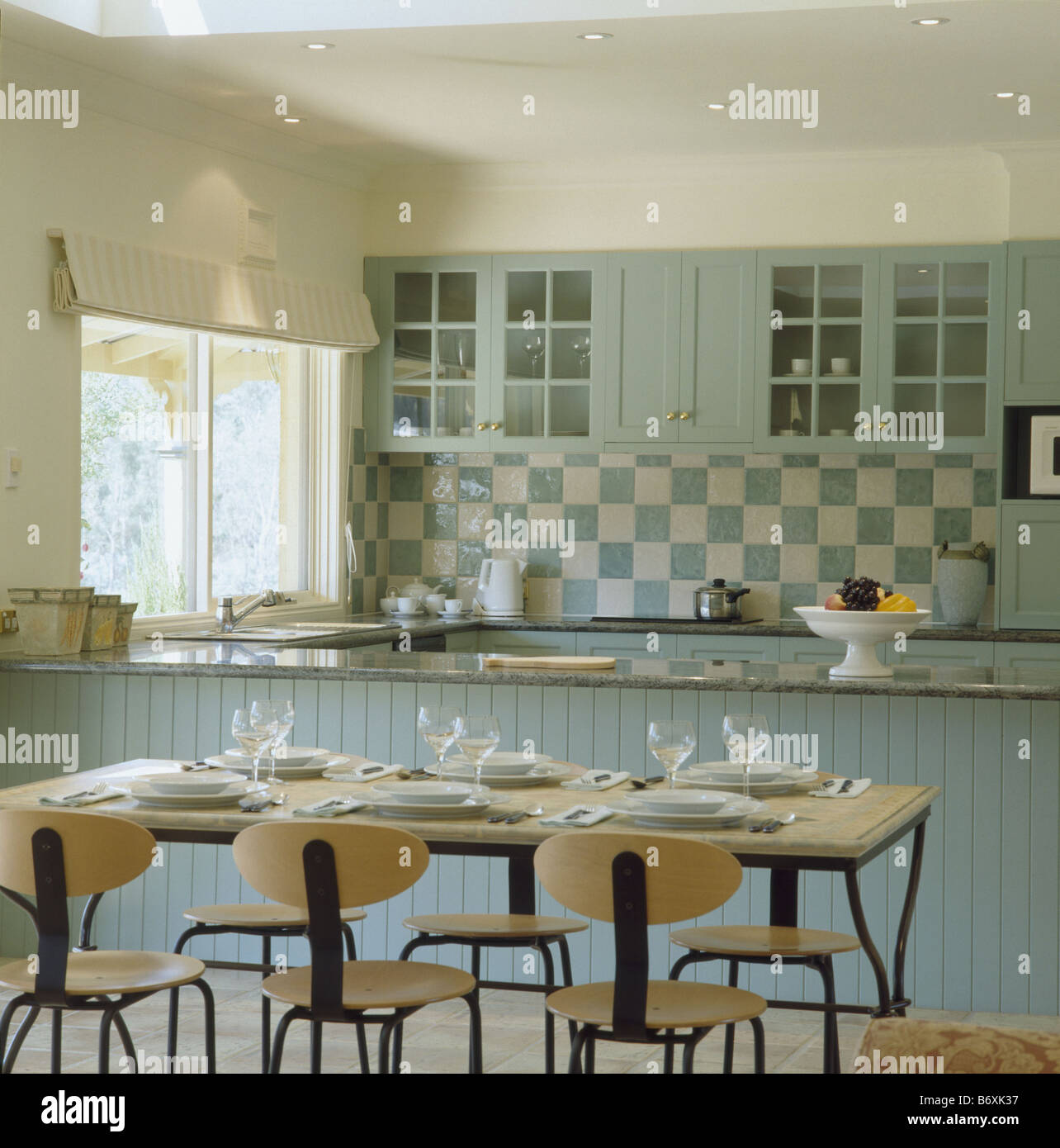 modern table and chairs in traditional kitchen dining room with pastel B6XK37