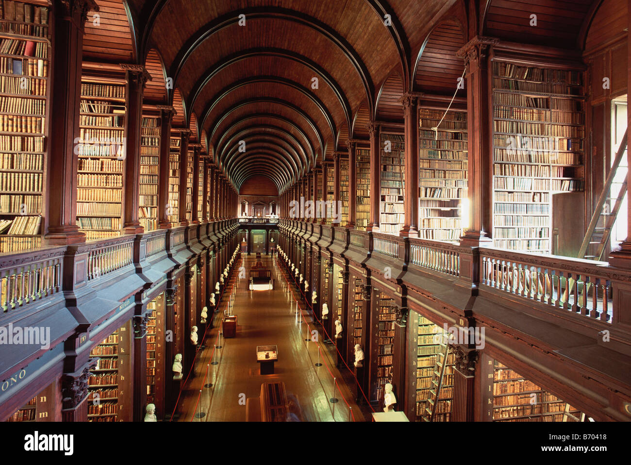 Long Foyer University : Rows of books inside trinity college long hall library