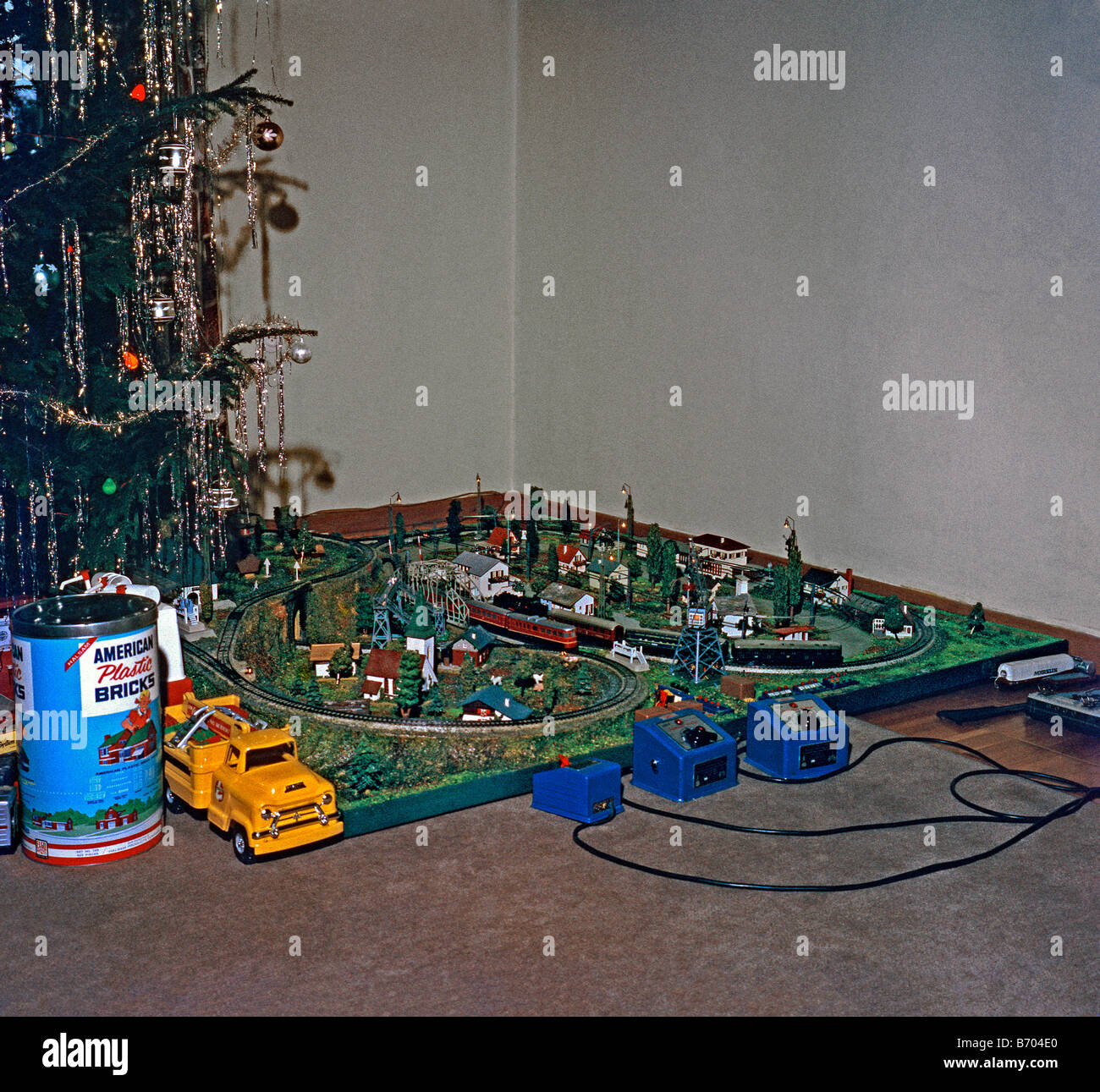 1960 Christmas Toys : Toy train set up at christmas c stock photo
