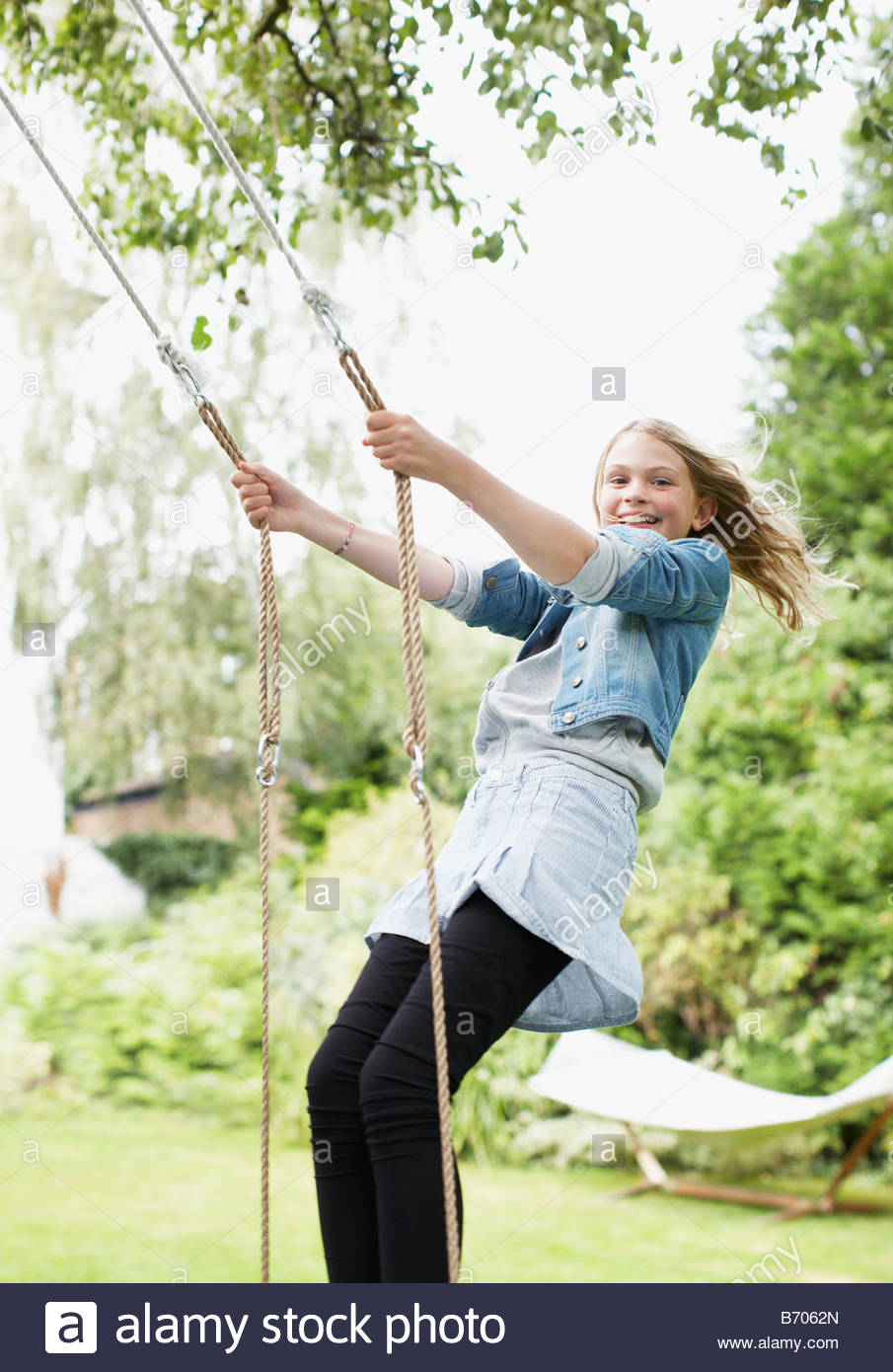 standing on swing in backyard stock photo royalty free image