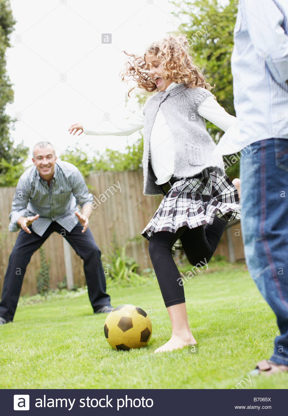 family playing soccer in backyard stock photo royalty free image