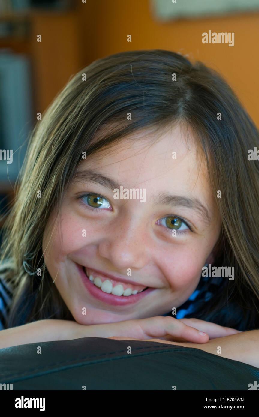 Smiling bright eyed 8 year old girl Stock Photo - smiling-bright-eyed-8-year-old-girl-B706WN