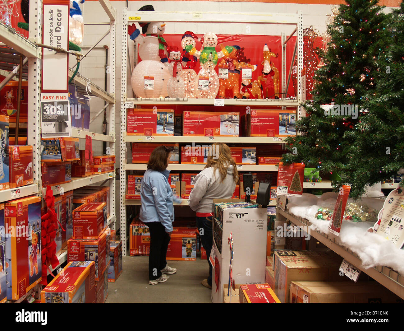 Shoppers looking for Christmas decorations at a Home Depot store ...