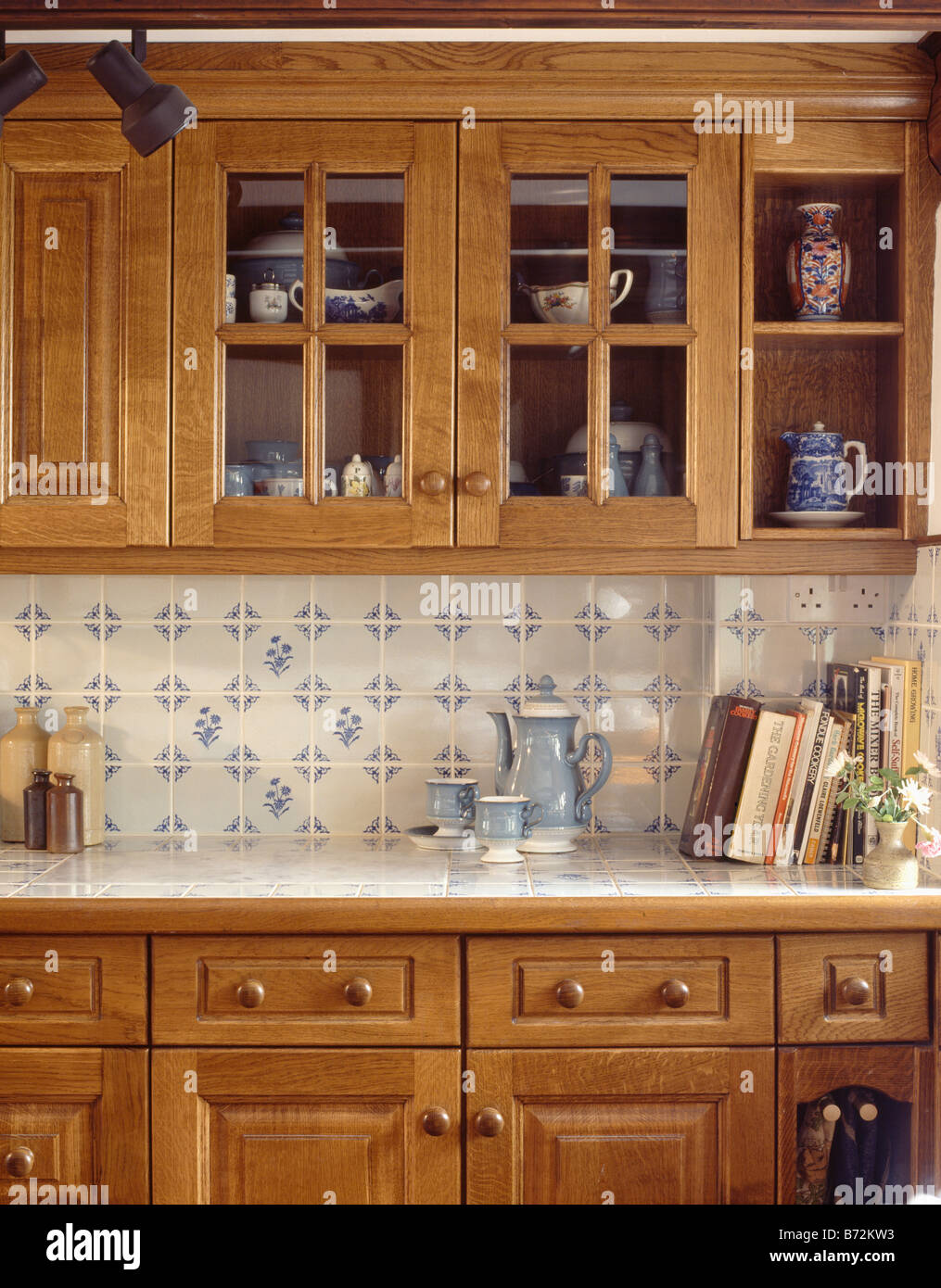 Close Up Of Coffee Pot And Cups On Worktop Below Blue U0026 White Wall Tiles In  Traditional Kitchen With Pine Cupboards