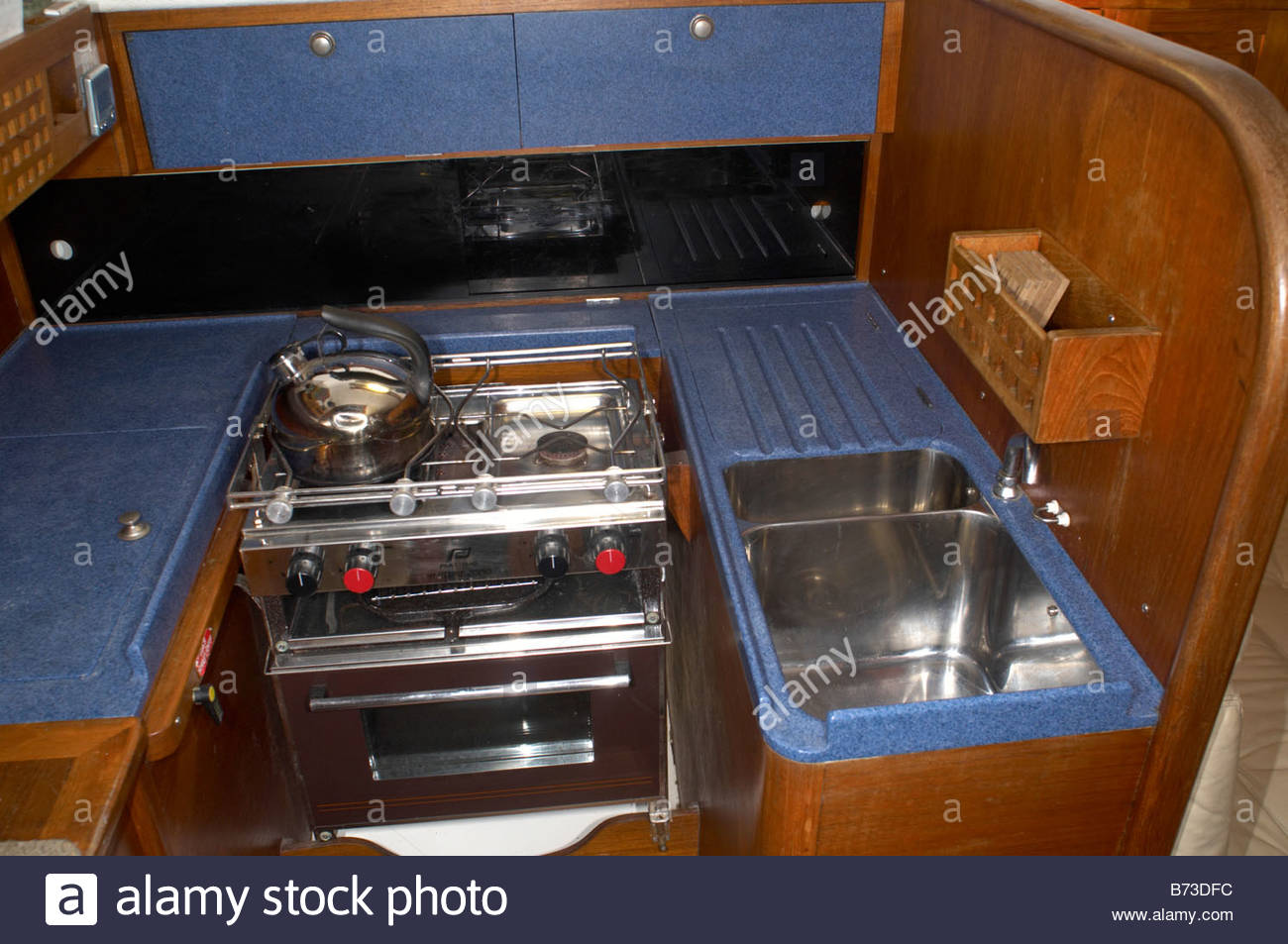 the interior of a contessa 32 yacht - the galley, or kitchen stock