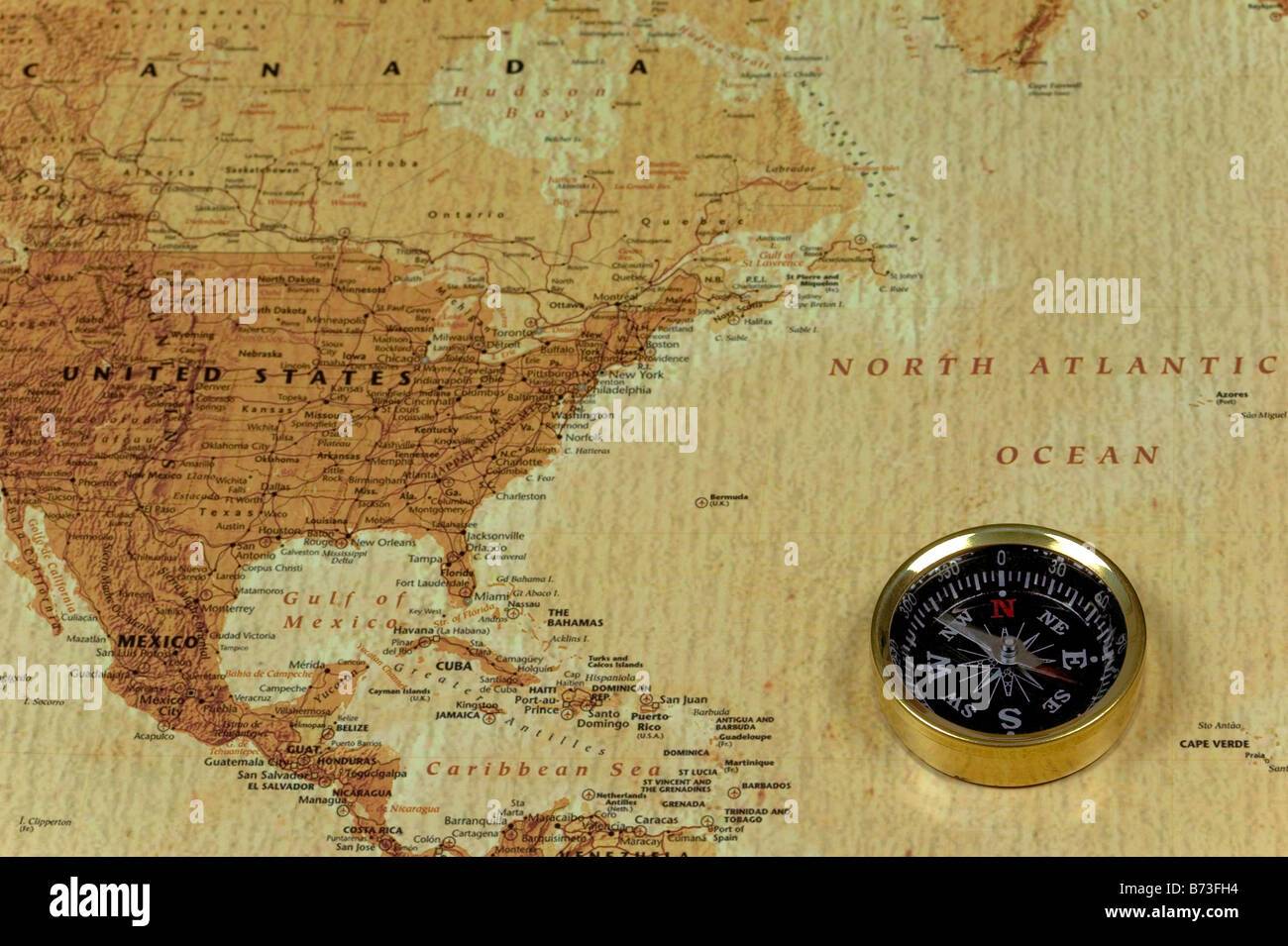 A Brss Compass On An Old Map Showing The North Atlantic Ocean And - Us map with compass